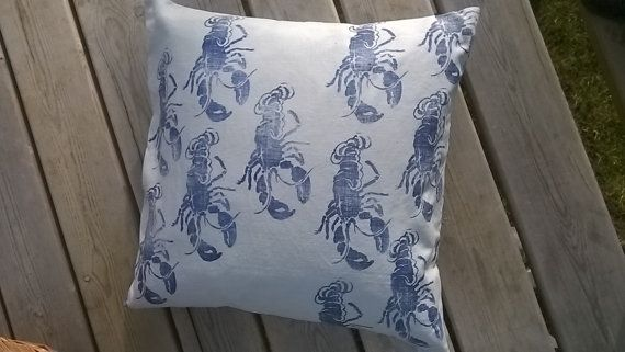 Hand printed cushion cover. One off. Blue Lobster repeat pattern linocut printed onto pale blue linen.