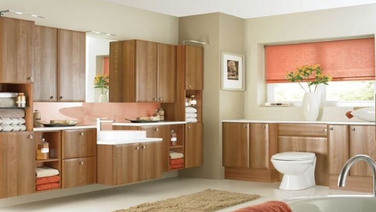COLOGNE AMATI WALNUT Amati Walnut saponetta doors on co-ordinating cabinets, the HA910 chrome drop knob handle and White Sparkle Gloss laminate worksurface and Round Vessel sit on basin. The Imago mirror with LED lights and sensor switch plus Star overlights are featured.