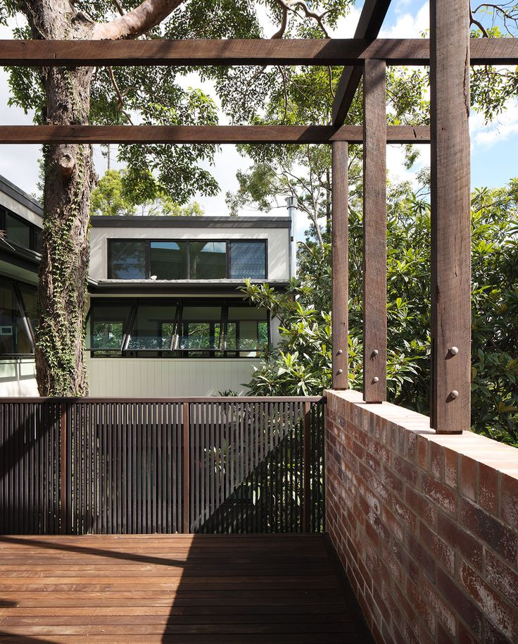 St Lucia House 1: Timber deck with brick wall and timber framing. See more at http://blighgraham.com.au/projects/st-lucia