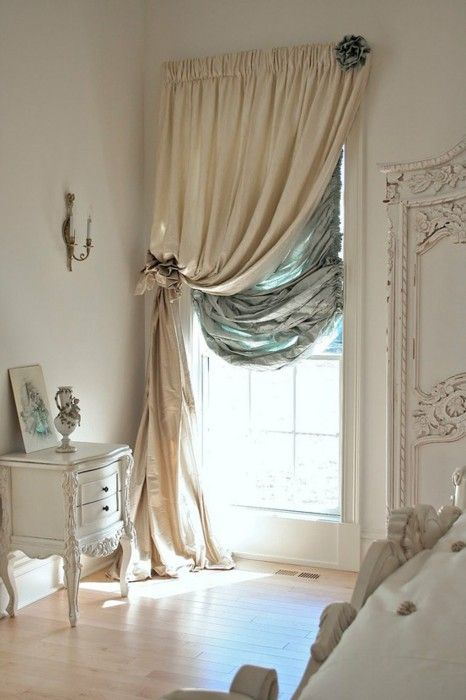 Elegant window treatment, but even more stunning are those old, HUGE windows. Oh how I would love to have windows and sunlight like that...