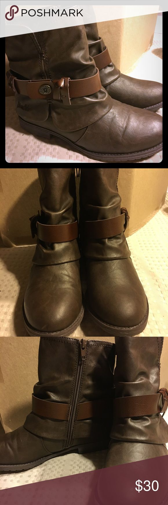 """New never worn cute brown booties! Dark brown with stylish belted (for show) ankle booties! My daughter does not like them & says they are a little tight across bridge of her foot so they may be a little more narrow fit until """"broken in"""".   Brand new without tags! See sole in pic no wear at all! They have a zipper on inside & wear true to size.  Already removed tags & recycled the box so they will be shipped in a different brand box just an FYI 😉 Blowfish Shoes Ankle Boots & Booties"""