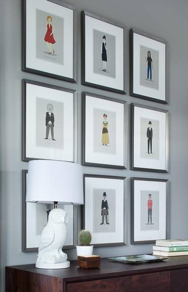 Art should have impact in a room. Here, we went with a print series of nine pop culture icons including Charlie Chaplin, Marilyn Monroe and Andy Warhol. (Barry Calhoun /Barry Calhoun)