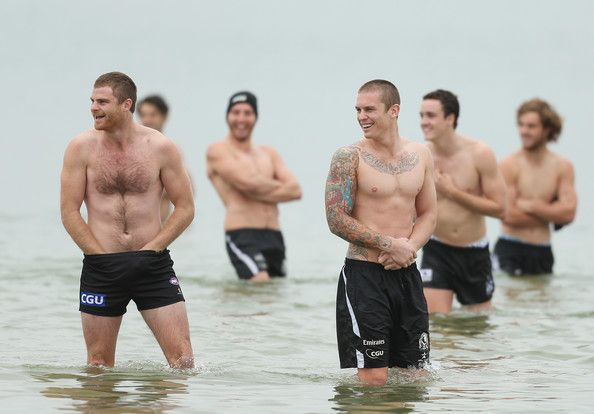Heath.Shaw (L) and Dayne Beams (3rd R) of the Magpies wade in the water during a Collingwood Magpies AFL recovery session at St Kilda Sea Baths on May 7, 2013 in Melbourne, Australia.