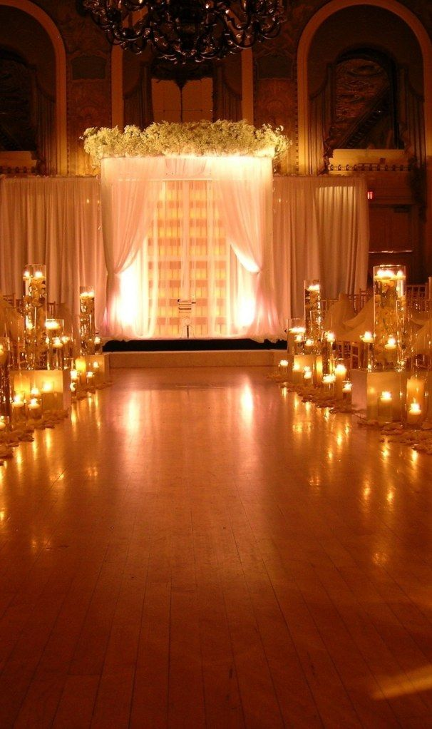 Love the aisle lit up with candles. I don't like the harsh, natural lighting for a wedding. It's just not as romantic.