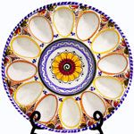 Handcrafted Spanish Cermaics egg plate in the Traditional Multicolored style.