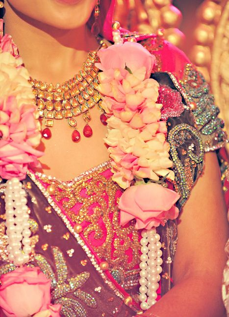 Perhaps consider (white?) flower garland with pearl or crystal bead accents? According to http://en.wikipedia.org/wiki/Garland - 'In India...flower garlands have an important and traditional role in every festival...Some of those flowers [used] are as follows: jasmine, champaka, lotus, lillies, ashoka, nerium/oleander, chrysanthemum, roses, hibiscus, pinwheel flowers, manoranjitam etc.'