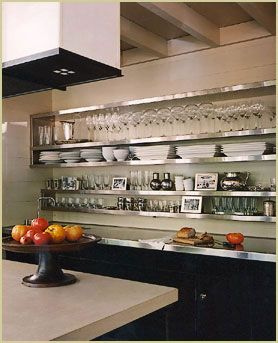 http://www.blogger.com/www.mcalpinetankersley.com Okay, this might just be open shelving in a Kitchen but it serves the same purpose none-the-less. I love the industrial chic stainless shelves... kind of like a trendy restaurant kitchen has moved into your house!