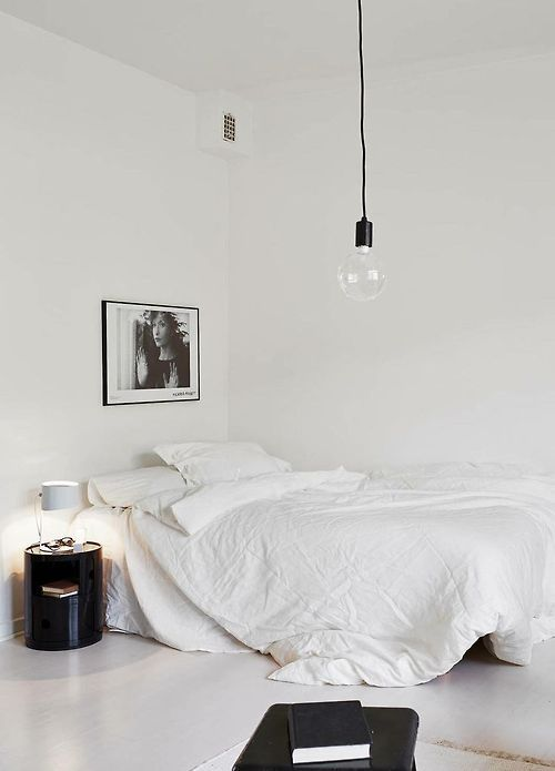 Love the clean and simple white bedroom with subtle black accents.