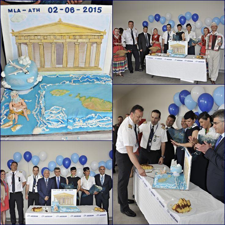 . Malta International Airport Luqa Airport / Valletta Airport IATA: MLA – ICAO: LMML Η τούρτα της υποδοχής , σε χρώματα Ελληνικά, κόβεται από τον κυβερνήτη κ. Αρνόκουρο παρουσία στελεχών της Aegean και του αεροδρομίου της Μάλτας.