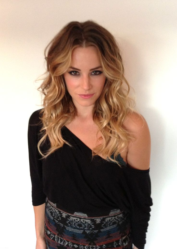 Blonde ombre sombre hair with a sexy lived in beachy texture.