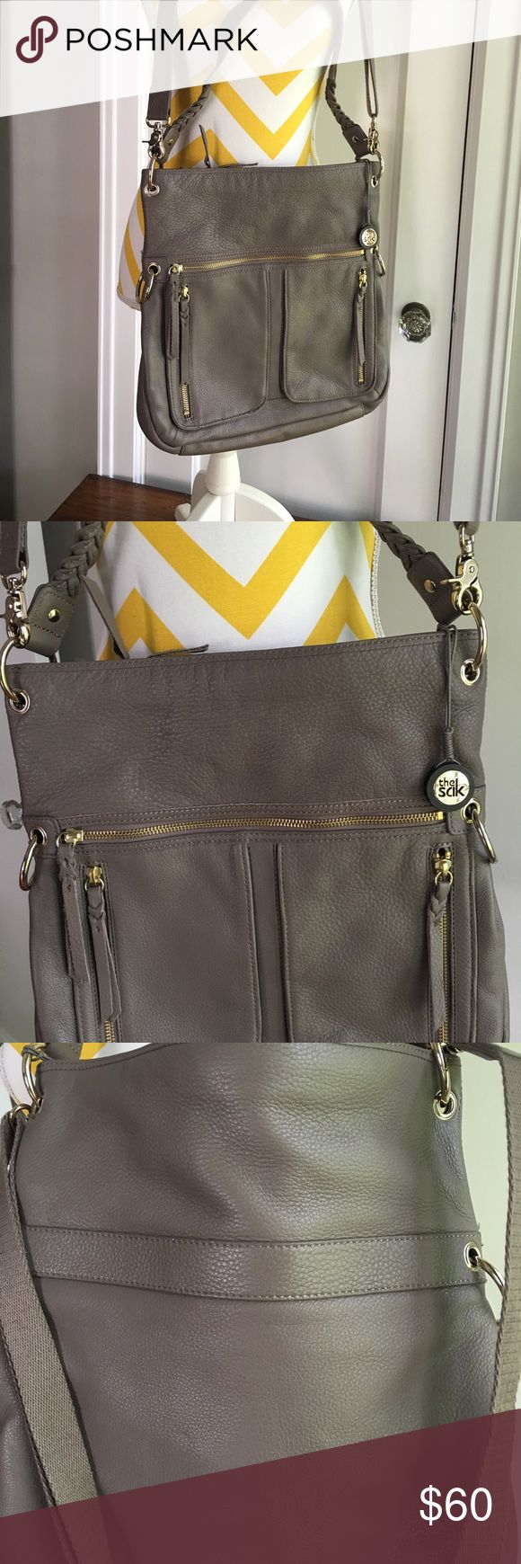 Sak 2 in one cross body / shoulder bag. Great cond Sak 2 in one cross body / shoulder bag. Great condition! This neutral bag goes with everything and fits all your necessities. Even big enough for an iPad, or notebook or books! Crossbody strap and shoulder strap. Many pockets. One small highlighter mark on side near seam (not noticeable) and one small string poking out(does not affect the bag at all) The Sak Bags Crossbody Bags