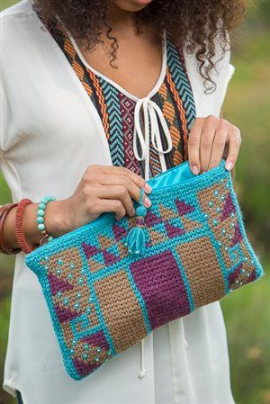 A modified single crochet, tapestry crochet, and a few beads make this crochet clutch one of a kind. Canyon Clutch