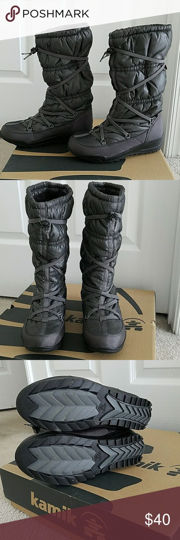 Kamik Woman's Snow boots, worn 2 times Stylish Comfortable Kamik Waterproof boots. In a slate/gray color with bungie cord that can be adjusted.  It's a 8, but narrow. If worn with thick socks, will be snug. Fits better a 7 or 7 1/2 with thick winter socks. Kamik Shoes Winter & Rain Boots