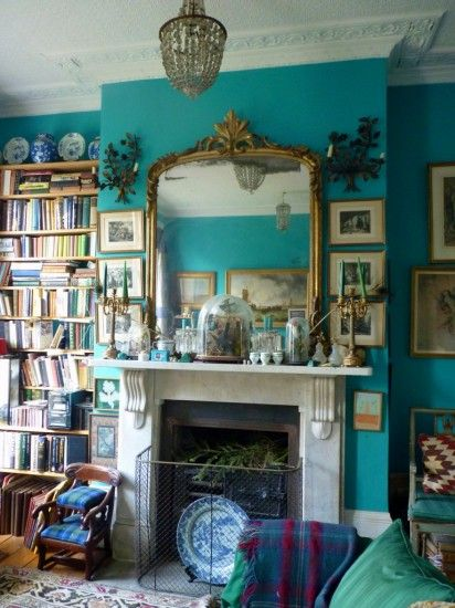 I'd like to swim in the wall color. . . + I'm always a fan of gallery walls and mismatched frames. . . blues and turquoise
