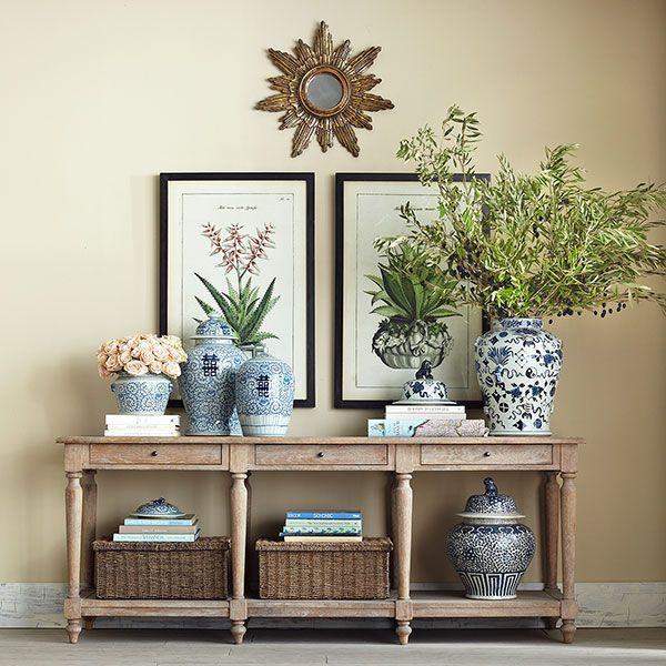 Console styling - sunburst mirror, framed art, blue and white ginger jar collection