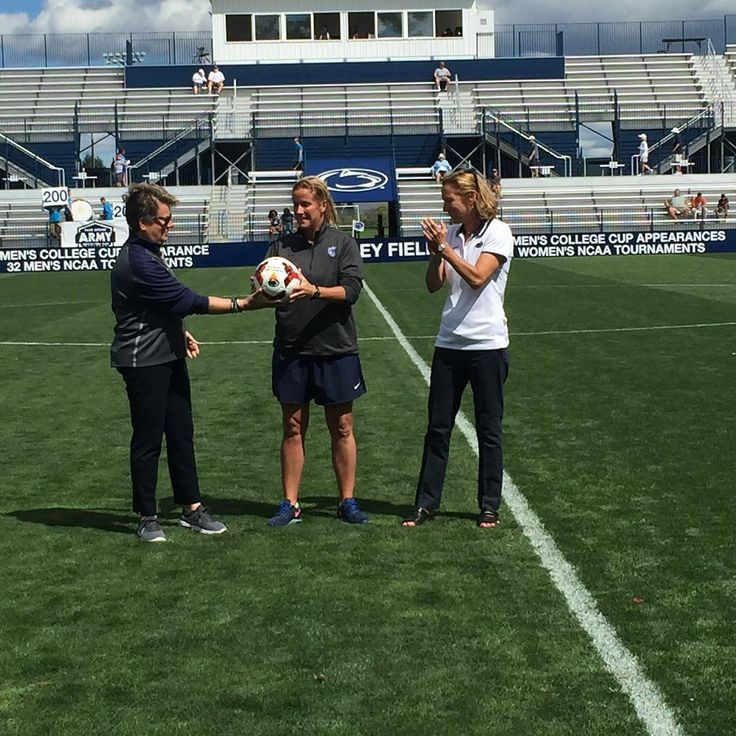 """See this Instagram photo by @pennstatewsoc • """"Coach Dambach received a commemorative game ball for her 200th victory prior to today's game! #WeAre #PSWS 🔵⚪️⚽️"""""""