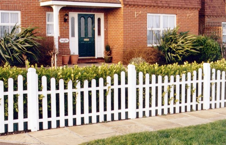 Traditional Concave Palisade Picket Fence Painted In A