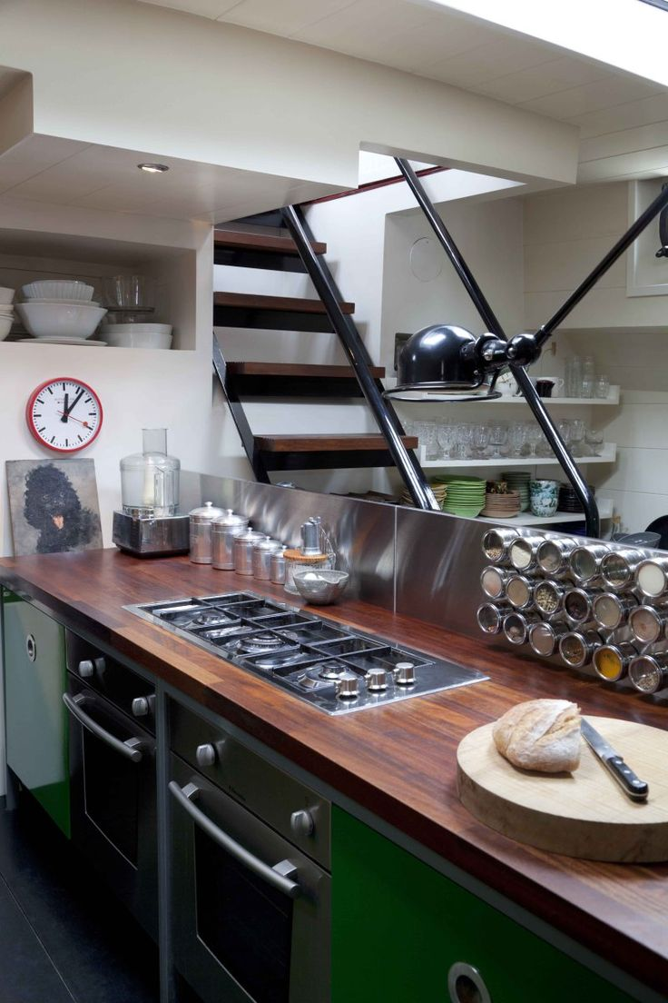 Amazing house boat interior. ::: Love the dark wood counter, s/s backsplash and magnetic spice jars.