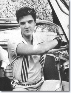 December 21, 1957...Elvis in the Colonel's red Isetta sports car which Elvis has just presented to him as a Christmas present.