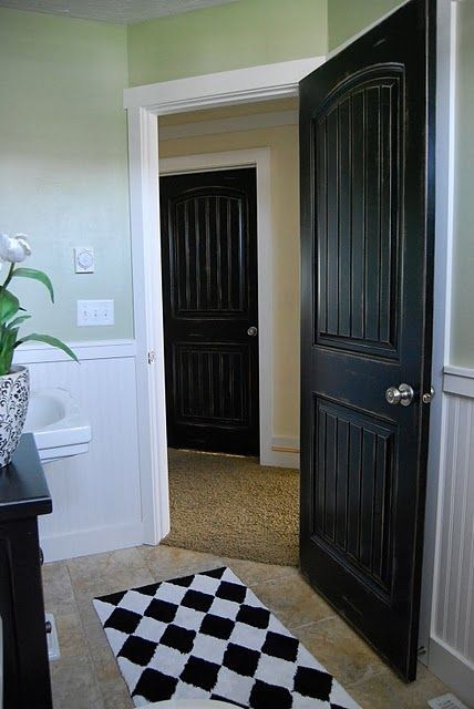 Love the black doors.  I've seen this before in some of the model homes we've been in while househunting, and really love how it looks.