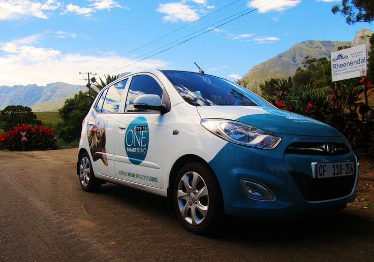 """From Twitter: """"@ross_jason: @BrandyourcarSA and @Tarryn Colson Ostrom on our way to @FANCOURTSA with our @Purina branded car"""""""