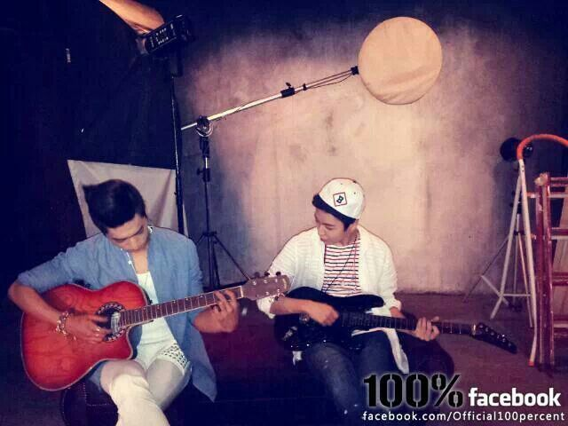 Sanghoon and Chanyong learning to play guitar