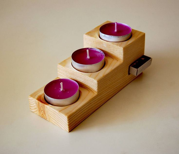 Handmade candle holder. Made entirely of recycled pinewood with a special place for matches. Made by S.M.Art.