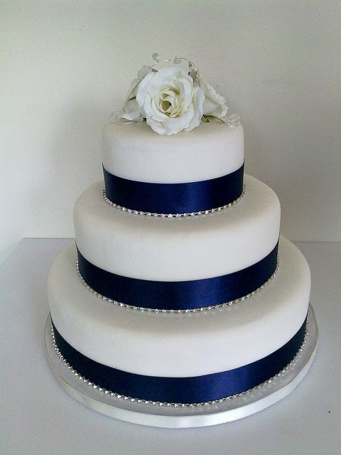 Three Tier Wedding Cake With Fondant Roses Ribbon And Broach