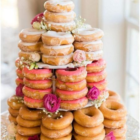 Scrumptious vintage doughnut wedding cake. Add frosting, roses, baby's breath and some greenery. Photo by Emily Sacra Photography.