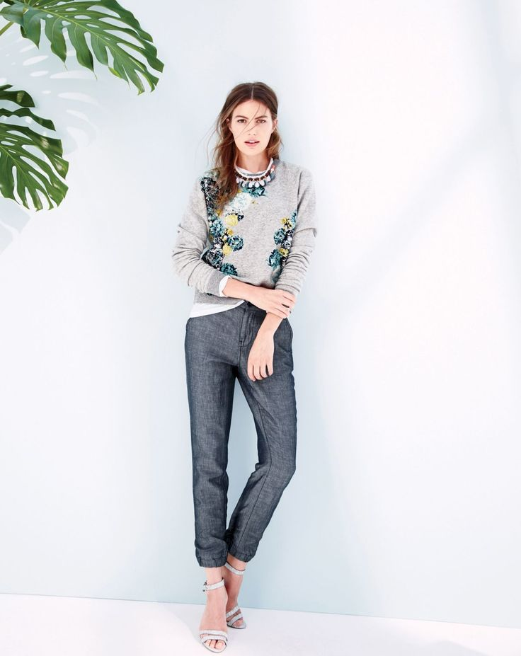 J.Crew women's aquatic floral sweatshirt in heather graphite, cuffed lightweight chambray pant, crystal palm leaf necklace and crackled ankle strap heels.