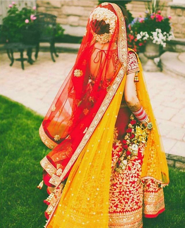 How we love this shot .. don't you? #photography #weddingphotography #gajra #lehenga #yellow #red #bridaldiaries #bride