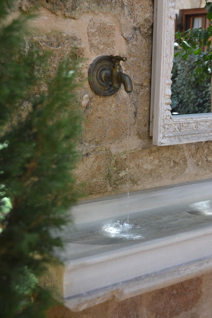 EXCLUSIVE SUITES BOUTIQUE HOTEL. MEDIEVAL TOWN, RHODES, GREECE. - The marble water basin from Tripoli, with the brass tap (originally used on wooden wine barrels) and the ottoman mirror.  - kokkiniporta.com