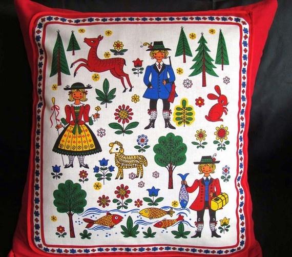 Scandinavian Folk Art cushion. Gives me an idea for a layout using my Scandinavian paper dolls.