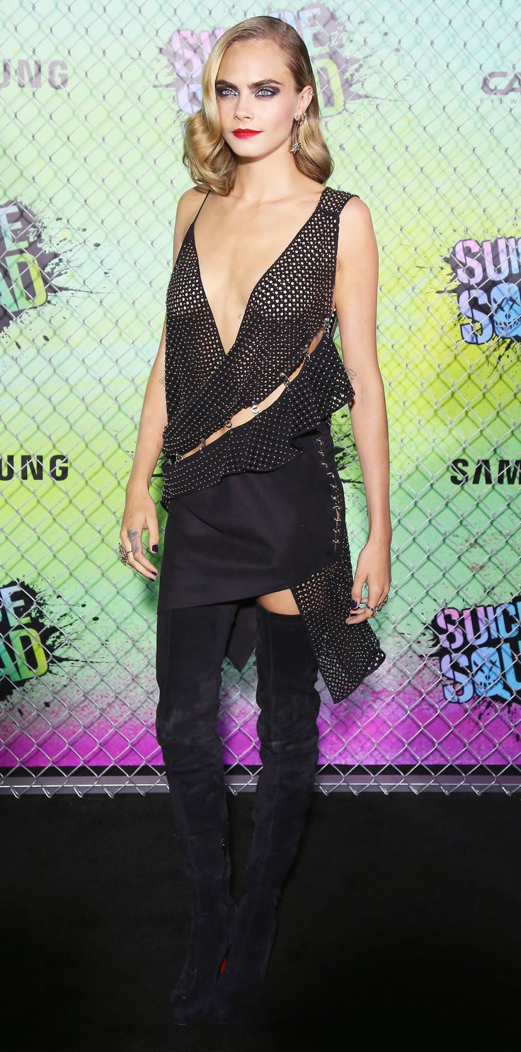 Cara Delevingne smoldered at the world premiere of Suicide Squad in a racy Anthony Vaccarello design that boasted a plunging neckline, sexy spliced cut-outs (pinned back together with silver hardware), and asymmetric ruffles. H.Stern diamonds delivered a generous dose of shine, while black suede Louboutin thigh-high boots (an unexpected red carpet footwear choice) offered coverage without compromising sex appeal.
