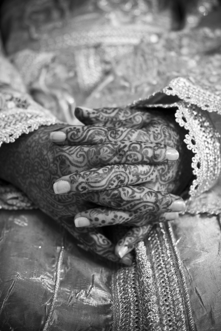 Hands decorated with henna at a Moroccan wedding in Fez, Morocco.