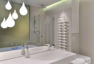 Mirror wall, pendant light, white tap