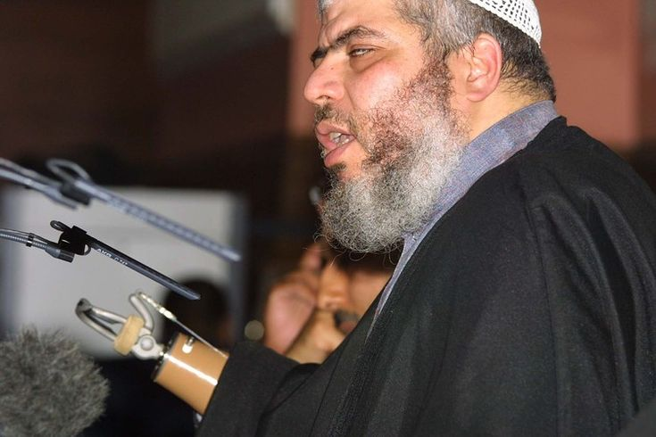 Abu Hamza al-Masri pictured in 2002 addressing a fundamentalist Islamic conference in London condemning what... Human garbage.