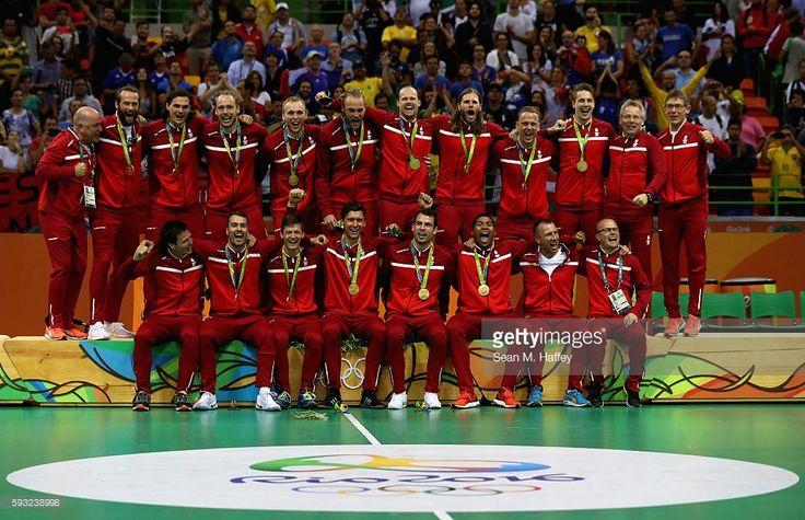 Team Denmark pose on the podium during the medal ceremony for Men's Handball…