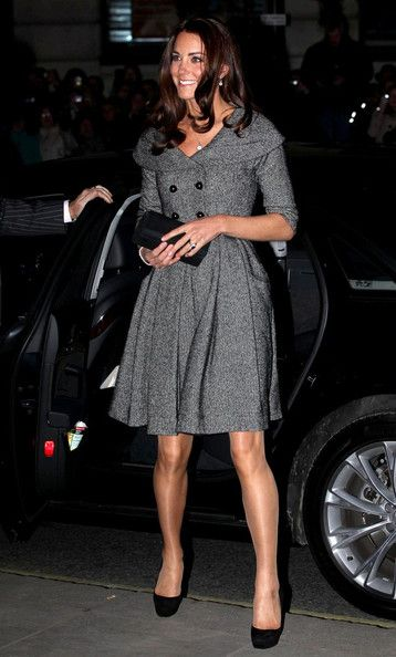 Catherine, Duchess of Cambridge wears a gray herringbone dress as she embarks on her first solo public engagement at the National Portrait Gallery where she will view the Lucian Freud Portrait exhibition.