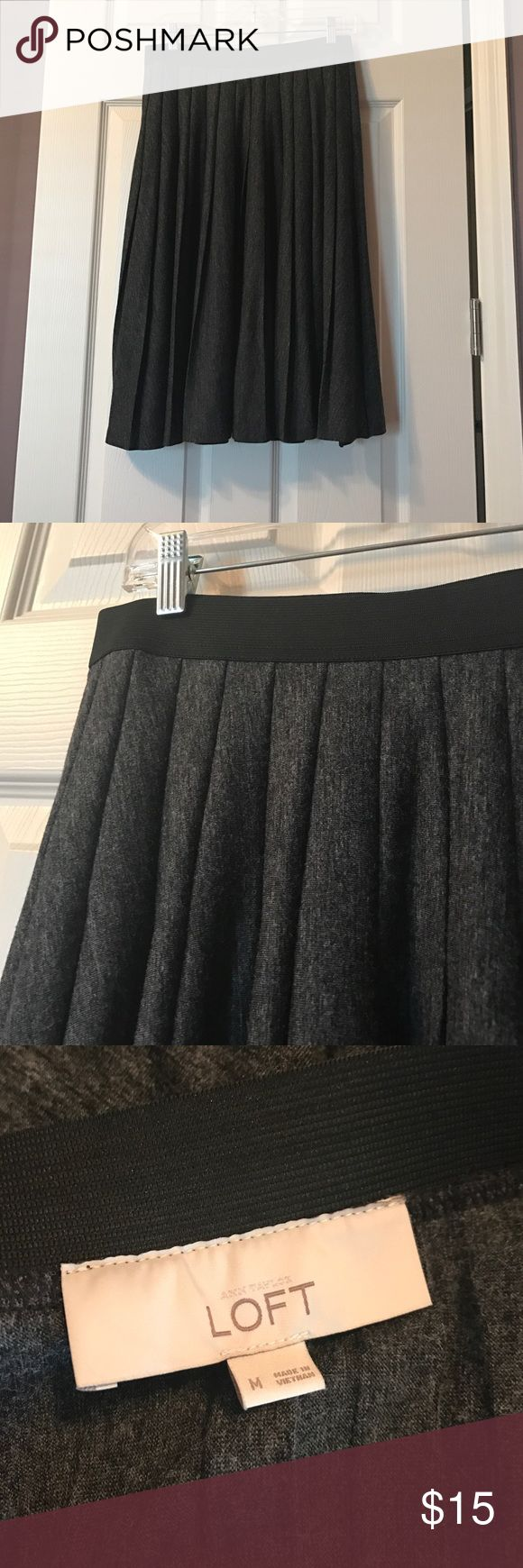 Dark gray pleated skirt Worn only once or twice. Elastic waist, zip on side. No lining. Machine washable. Polyester and Rayon. Calf length skirt. Great with tights and boots! LOFT Skirts Midi