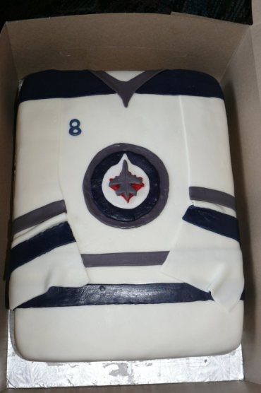 New Jets Jersey cake - Vanilla cake filled and iced with buttercream and covered in MMF. All designs and logos free hand.