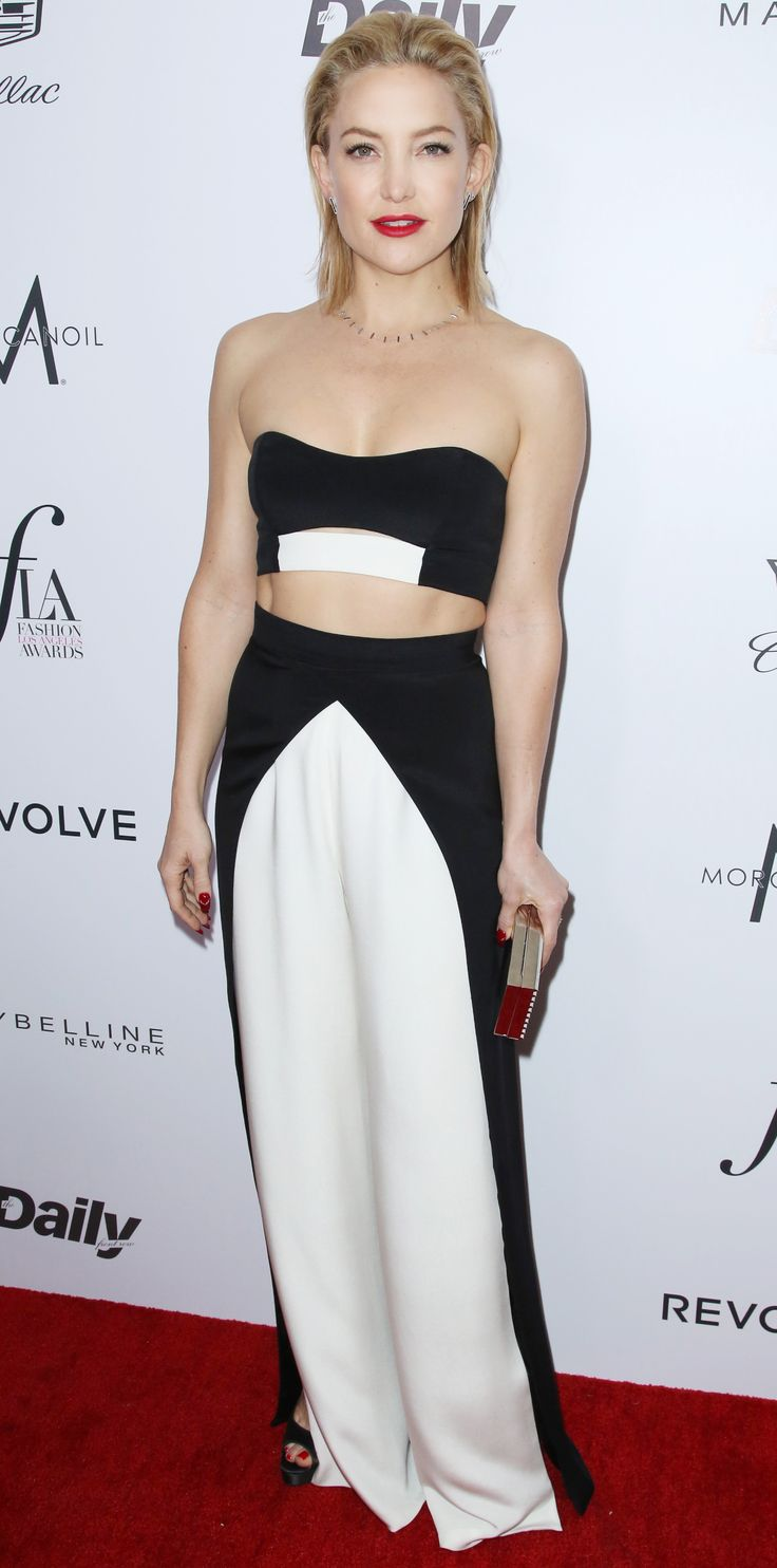 Kate Hudson showed off her hard-earned abs at the Fashion Los Angeles 2016 Awards in a black-and-white color-block bandeau and high-waist faux-wrap pants by August Getty Atelier, styling with Jennifer Meyer jewelry and a Lee Savage box clutch.
