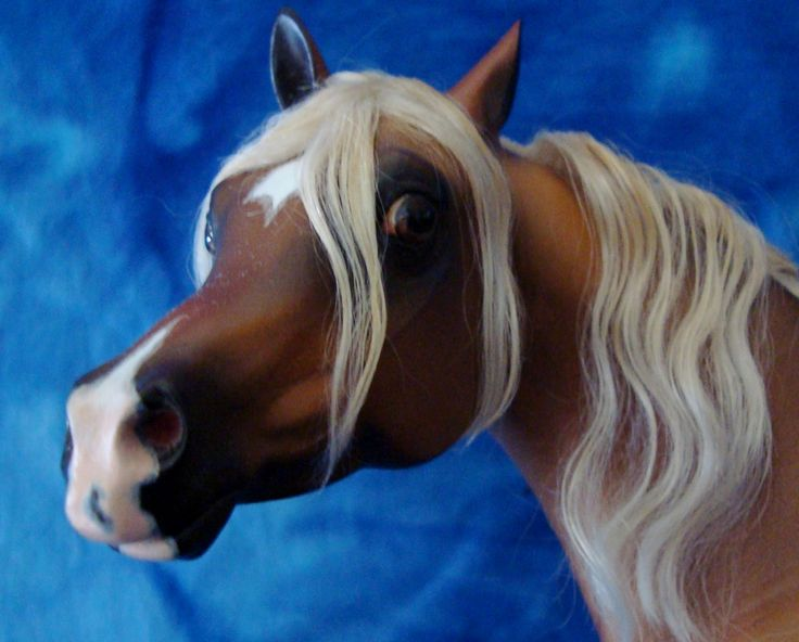 This beauty is a Sarah Rose Nahar resin customized by the very talented Faye Cohen.  She was airbrushed to a coppery liver chestnut.  She also has metal horse shoes, with correct nail holes, mohair mane and tail, correct mare anatomy, and mapping around her markings. This lady has been my holy grail for years I am so honored to finally own her.