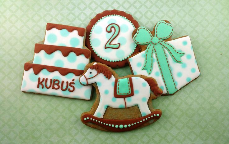 Birthday cookies for boy. Cake, gift-box and rocking horse.