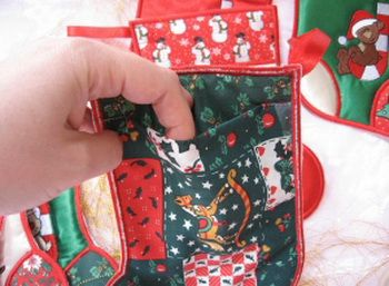 MSP091 - Christmas Stocking Quick, easy and a treat to stitch out!  These Christmas Stockings are made all 'in hoop' and are completed in one hooping - no extra sewing required.  The built in pocket at the back of the Christmas Stocking is ideal for small gifts or treats and would look great hung on the fireplace mantle or put on the Christmas Tree.  I used Satin fabric and poly cotton Christmas Print Fabric.   http://tinyurl.com/hx7jp5c