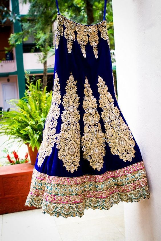 Bridal lehenga in blue. Comes with matching choli and dupatta