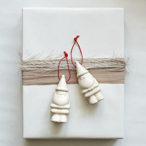 They look kinda gnomish to me.  Porcelain Santa Ornament | west elm