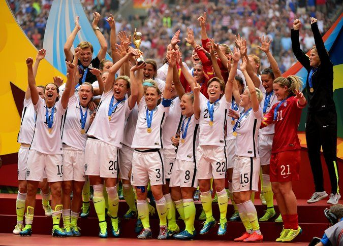 July 5, 2015 -- In a Rout and a Romp, U.S. Takes World Cup - Abby Wambach (20) and Christie Rampone (3) held the World Cup trophy aloft after the United States' win over Japan. Rampone, 40, had been a part of the last U.S. team to win it, in 1999. The New York Times