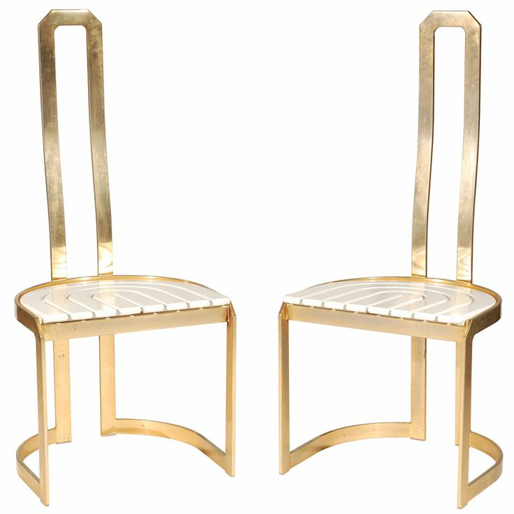 A Pair of Sculptural High Back Dining Chairs in Brass  ITALY  1970s  A Pair of Sculptural High Back Dining Chairs in Brass. ITA, 1970s. A pair of high-back dining chairs with white acrylic seats in polished bronze. A beautiful and economical form with curved and slatted seats.