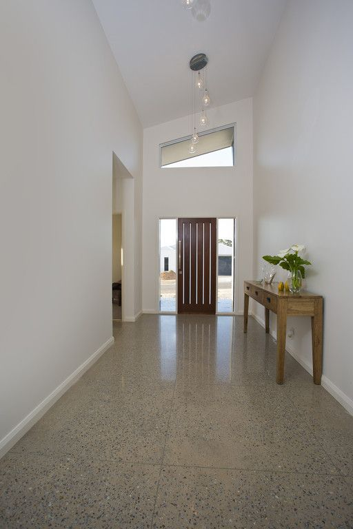 Entrance - raked ceiling and windows each side of door and tiles that look like polished concrete!